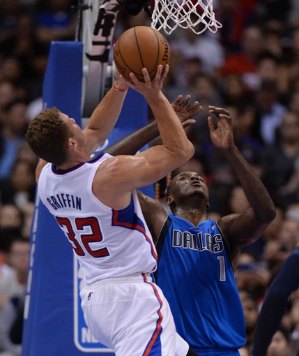 Apr 3, 2014; Los Angeles, CA, USA;   Dallas Mavericks center Samuel Dalembert (1) fouls Los Angeles Clippers forward Blake Griffin (32) during the second half of the game at Staples Center. Mavericks won 113-107. Mandatory Credit: Jayne Kamin-Oncea-USA TODAY Sports