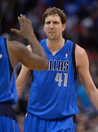 Apr 3, 2014; Los Angeles, CA, USA;  Dallas Mavericks forward Dirk Nowitzki (41) reacts to a basket during the second half of the game against the Los Angeles Clippers at Staples Center. Mavericks won 113-107. Mandatory Credit: Jayne Kamin-Oncea-USA TODAY Sports