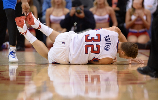 Apr 3, 2014; Los Angeles, CA, USA;   Los Angeles Clippers forward Blake Griffin (32) lands on the court in the second half of the game against the Dallas Mavericks at Staples Center. Mavericks won 113-107. Mandatory Credit: Jayne Kamin-Oncea-USA TODAY Sports