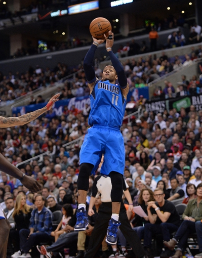 Apr 3, 2014; Los Angeles, CA, USA;   Dallas Mavericks guard Monta Ellis (11) takes a jump shot in the second half of the game against the Los Angeles Clippers at Staples Center. Mavericks won 113-107. Mandatory Credit: Jayne Kamin-Oncea-USA TODAY Sports