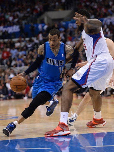 Apr 3, 2014; Los Angeles, CA, USA;   Los Angeles Clippers center DeAndre Jordan (6) guards Dallas Mavericks guard Monta Ellis (11) in the second half of the game at Staples Center. Mavericks won 113-107. Mandatory Credit: Jayne Kamin-Oncea-USA TODAY Sports