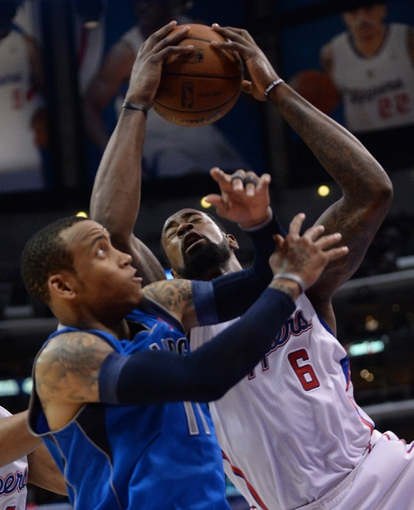 Apr 3, 2014; Los Angeles, CA, USA;   Los Angeles Clippers center DeAndre Jordan (6) grabs a rebound in front of Dallas Mavericks guard Monta Ellis (11) in the second half of the game at Staples Center. Mavericks won 113-107. Mandatory Credit: Jayne Kamin-Oncea-USA TODAY Sports
