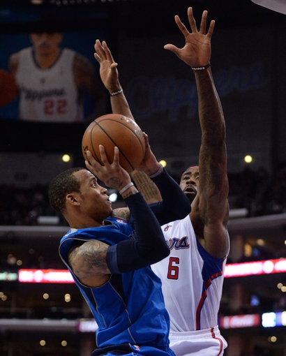 Apr 3, 2014; Los Angeles, CA, USA;   Los Angeles Clippers center DeAndre Jordan (6) blocks a shot by Dallas Mavericks guard Monta Ellis (11) in the second half of the game at Staples Center. Mavericks won 113-107. Mandatory Credit: Jayne Kamin-Oncea-USA TODAY Sports