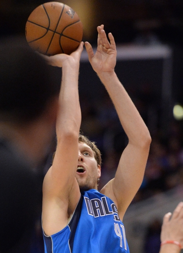 Apr 3, 2014; Los Angeles, CA, USA;   Dallas Mavericks forward Dirk Nowitzki (41) takes a jump shot in the second half of the game against the Los Angeles Clippers at Staples Center. Mavericks won 113-107. Mandatory Credit: Jayne Kamin-Oncea-USA TODAY Sports