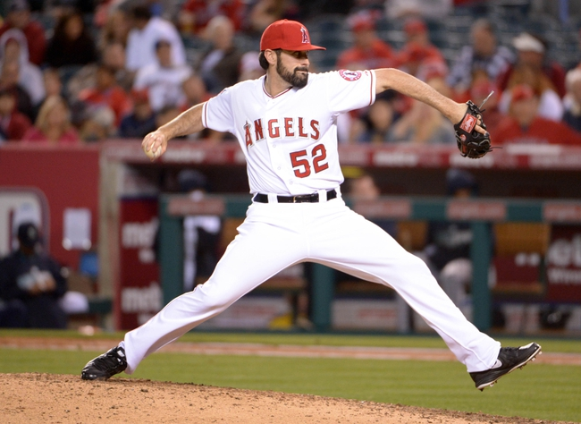 Apr 1, 2014; Anaheim, CA, USA; Los Angeles Angels reliever Matt Shoemaker (52) delivers a pitch against the Seattle Mariners at Angel Stadium of Anaheim. The Mariners defeated the Angels 8-3. Mandatory Credit: Kirby Lee-USA TODAY Sports
