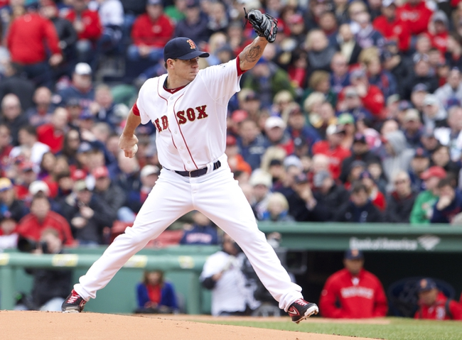 Apr 4, 2014; Boston, MA, USA; Boston Red Sox starting pitcher Jake Peavy (44) throws a pitch against the Milwaukee Brewers in the first inning of an opening day baseball game at Fenway Park. Mandatory Credit: David Butler II-USA TODAY Sports