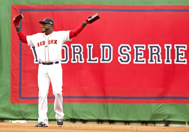 Apr 4, 2014; Boston, MA, USA; Boston Red Sox designated hitter David Ortiz (34) reacts after receiving his 2013 World Series ring before the game against the Milwaukee Brewers at Fenway Park. Mandatory Credit: David Butler II-USA TODAY Sports