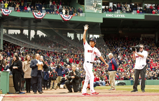 Apr 4, 2014; Boston, MA, USA; Boston Red Sox Koji Uehara (19) waves to the crowd as he heads out to receive his 2013 World Series ring before the game against the Milwaukee Brewers at Fenway Park. Mandatory Credit: David Butler II-USA TODAY Sports