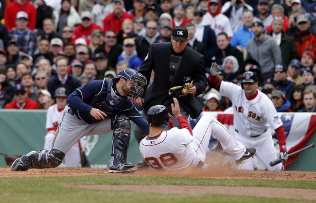 Apr 4, 2014; Boston, MA, USA; Boston Red Sox center fielder Grady Sizemore (38) is tagged out at home plate against Milwaukee Brewers catcher Jonathan Lucroy (20) in the second inning at Fenway Park. Mandatory Credit: David Butler II-USA TODAY Sports