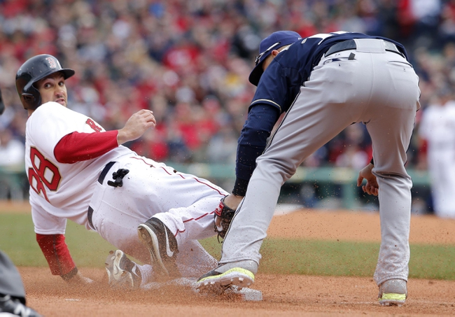 Apr 4, 2014; Boston, MA, USA; Boston Red Sox center fielder Grady Sizemore (38) steals third base against Milwaukee Brewers third baseman Aramis Ramirez (16) in the second inning at Fenway Park. Mandatory Credit: David Butler II-USA TODAY Sports