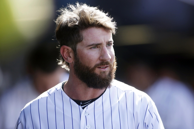 Apr 4, 2014; Denver, CO, USA; Colorado Rockies center fielder Charlie Blackmon (19) in the dugout during the fourth inning against the Arizona Diamondbacks at Coors Field. Mandatory Credit: Chris Humphreys-USA TODAY Sports