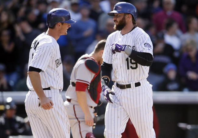 Apr 4, 2014; Denver, CO, USA; Colorado Rockies center fielder Charlie Blackmon (19) celebrates with second baseman D.J. LeMahieu (left) after hitting a home run during the fourth inning against the Arizona Diamondbacks at Coors Field. Mandatory Credit: Chris Humphreys-USA TODAY Sports