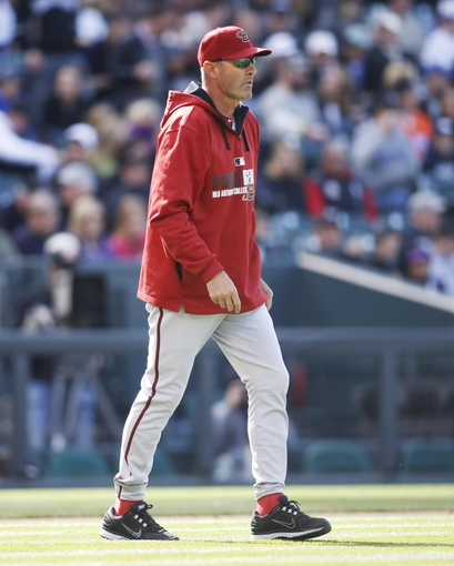 Apr 4, 2014; Denver, CO, USA; Arizona Diamondbacks manager Kirk Gibson comes onto the field to relieve starting pitcher Randall Delgado (not pictured) during the fifth inning against the Colorado Rockies at Coors Field. Mandatory Credit: Chris Humphreys-USA TODAY Sports