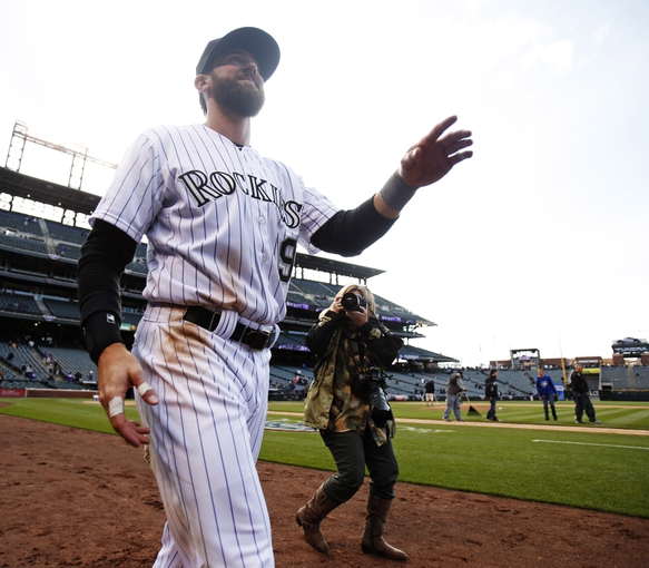 Apr 4, 2014; Denver, CO, USA; Colorado Rockies left fielder Charlie Blackmon (19) after the game against the Arizona Diamondbacks at Coors Field. Blackmon went six for six during the game, tying a franchise record. The Rockies won 12-2. Mandatory Credit: Chris Humphreys-USA TODAY Sports