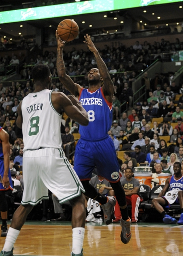 Apr 4, 2014; Boston, MA, USA; Philadelphia 76ers guard Tony Wroten (8) shoots the ball over Boston Celtics forward Jeff Green (8) during the first half at TD Garden. Mandatory Credit: Bob DeChiara-USA TODAY Sports