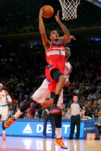 Apr 4, 2014; New York, NY, USA; Washington Wizards small forward Trevor Ariza (1) drives to the basket past New York Knicks power forward Amar'e Stoudemire (1) during the first quarter of a game at Madison Square Garden. Mandatory Credit: Brad Penner-USA TODAY Sports