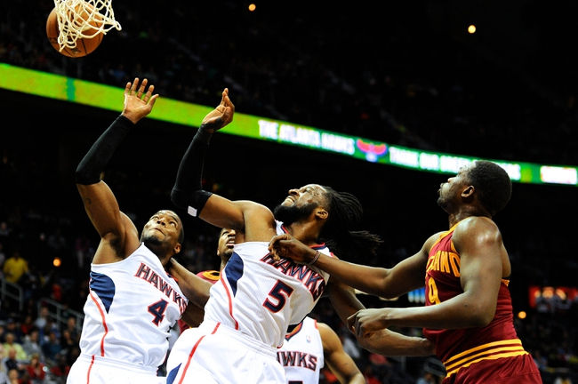 Apr 4, 2014; Atlanta, GA, USA; Atlanta Hawks forward Paul Millsap (4) and forward DeMarre Carroll (5) fight for a rebound with Cleveland Cavaliers forward Tristan Thompson (13) and forward Luol Deng (9) during the first half at Philips Arena. Mandatory Credit: Dale Zanine-USA TODAY Sports