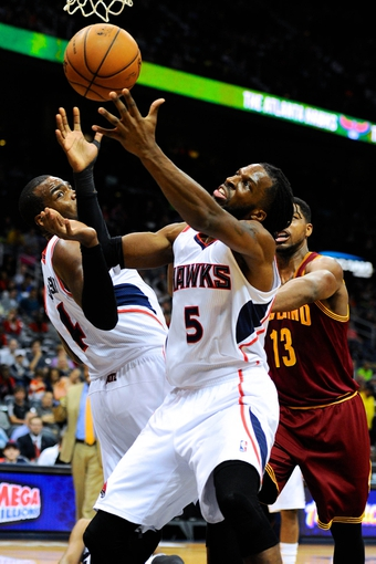 Apr 4, 2014; Atlanta, GA, USA; Atlanta Hawks  forward DeMarre Carroll (5) controls a rebound against Cleveland Cavaliers forward Tristan Thompson (13) during the first half at Philips Arena. Mandatory Credit: Dale Zanine-USA TODAY Sports