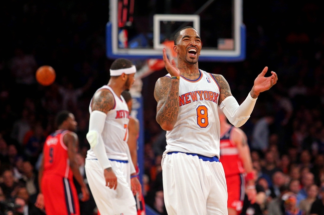 Apr 4, 2014; New York, NY, USA; New York Knicks shooting guard J.R. Smith (8) reacts at the end of the second quarter of a game against the Washington Wizards at Madison Square Garden. Mandatory Credit: Brad Penner-USA TODAY Sports