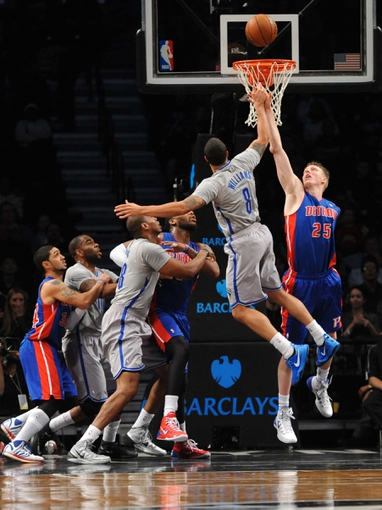 Apr 4, 2014; Brooklyn, NY, USA; Detroit Pistons forward Kyle Singler (25) blocks a shot by Brooklyn Nets guard Deron Williams (8) during the first half at Barclays Center. Mandatory Credit: Joe Camporeale-USA TODAY Sports