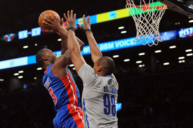 Apr 4, 2014; Brooklyn, NY, USA; Detroit Pistons guard Rodney Stuckey (3) shoots over Brooklyn Nets center Jason Collins (98) during the first half at Barclays Center. Mandatory Credit: Joe Camporeale-USA TODAY Sports