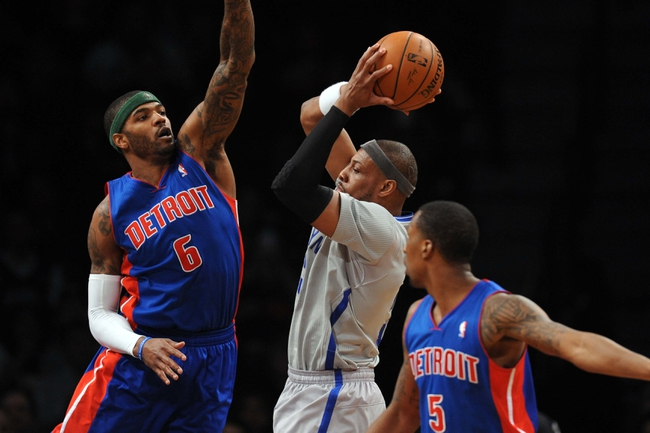 Apr 4, 2014; Brooklyn, NY, USA; Detroit Pistons forward Josh Smith (6) and Detroit Pistons guard Kentavious Caldwell-Pope (5) guard Brooklyn Nets forward Paul Pierce (34) during the first half at Barclays Center. Mandatory Credit: Joe Camporeale-USA TODAY Sports