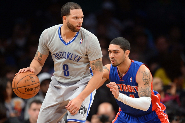 Apr 4, 2014; Brooklyn, NY, USA; Detroit Pistons guard Peyton Siva (34) guards Brooklyn Nets guard Deron Williams (8) during the first half at Barclays Center. Mandatory Credit: Joe Camporeale-USA TODAY Sports