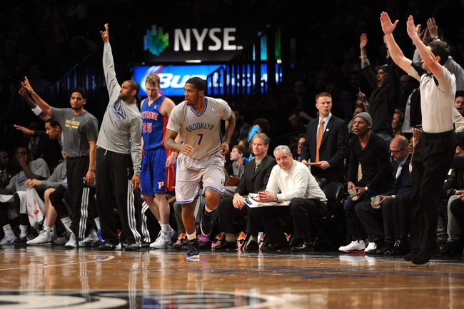 Apr 4, 2014; Brooklyn, NY, USA; Brooklyn Nets guard Joe Johnson (7) reacts after a three point basket against the Detroit Pistons during the first half at Barclays Center. Mandatory Credit: Joe Camporeale-USA TODAY Sports
