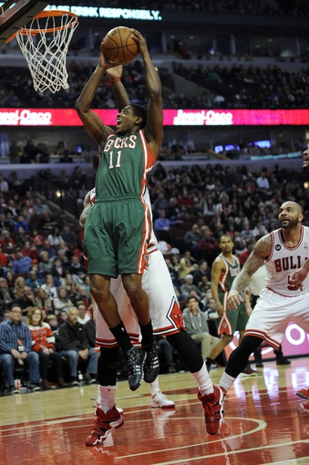 Apr 4, 2014; Chicago, IL, USA;  Milwaukee Bucks guard Brandon Knight (11) is defended by Chicago Bulls guard Jimmy Butler (21) during the first quarter at the United Center. Mandatory Credit: David Banks-USA TODAY Sports