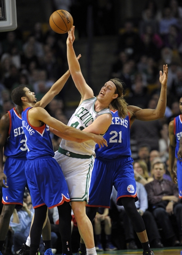 Apr 4, 2014; Boston, MA, USA; Boston Celtics center Kelly Olynyk (41) and Philadelphia 76ers guard Michael Carter-Williams (1) battle for a loose ball during the first half at TD Garden. Mandatory Credit: Bob DeChiara-USA TODAY Sports