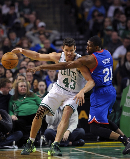 Apr 4, 2014; Boston, MA, USA; Philadelphia 76ers forward Thaddeus Young (21) tries to steal the ball from Boston Celtics center Kris Humphries (43) during the first half at TD Garden. Mandatory Credit: Bob DeChiara-USA TODAY Sports