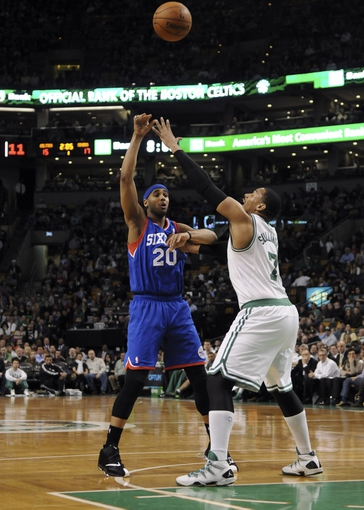 Apr 4, 2014; Boston, MA, USA; Philadelphia 76ers forward Brandon Davies (20) passes the ball over Boston Celtics center Jared Sullinger (7) during the first half at TD Garden. Mandatory Credit: Bob DeChiara-USA TODAY Sports