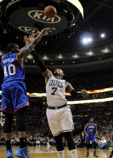 Apr 4, 2014; Boston, MA, USA; Philadelphia 76ers forward Jarvis Varnado (40) shoots the ball over Boston Celtics center Jared Sullinger (7) during the first half at TD Garden. Mandatory Credit: Bob DeChiara-USA TODAY Sports