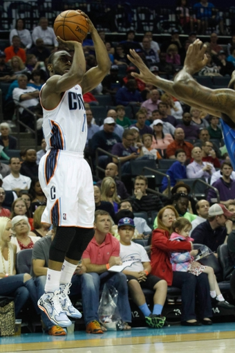 Apr 4, 2014; Charlotte, NC, USA; Charlotte Bobcats guard Kemba Walker (15) shoots the ball during the second half against the Orlando Magic at Time Warner Cable Arena. The Bobcats defeated the Magic 91-80. Mandatory Credit: Jeremy Brevard-USA TODAY Sports