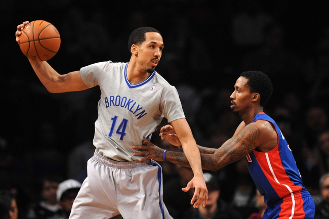Apr 4, 2014; Brooklyn, NY, USA; Brooklyn Nets guard Shaun Livingston (14) controls the ball against the Detroit Pistons during the first half at Barclays Center. The Nets won 116-104. Mandatory Credit: Joe Camporeale-USA TODAY Sports