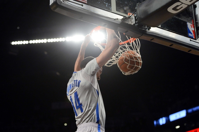 Apr 4, 2014; Brooklyn, NY, USA; Brooklyn Nets guard Shaun Livingston (14) dunks the ball against the Detroit Pistons during the second half at Barclays Center. The Nets won 116-104. Mandatory Credit: Joe Camporeale-USA TODAY Sports
