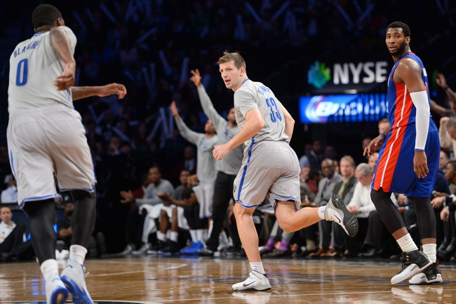 Apr 4, 2014; Brooklyn, NY, USA; Brooklyn Nets forward Mirza Teletovic (33) reacts after making a three point basket against the Detroit Pistons during the second half at Barclays Center. The Nets won 116-104. Mandatory Credit: Joe Camporeale-USA TODAY Sports