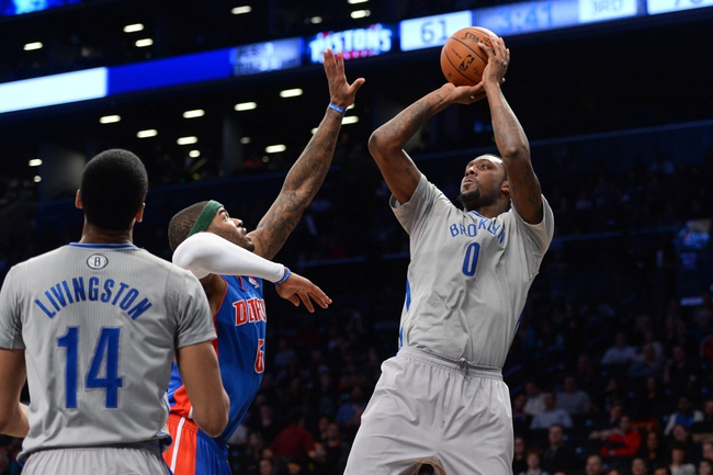 Apr 4, 2014; Brooklyn, NY, USA; Brooklyn Nets center Andray Blatche (0) shoots over Detroit Pistons forward Josh Smith (6) during the second half at Barclays Center. The Nets won 116-104. Mandatory Credit: Joe Camporeale-USA TODAY Sports