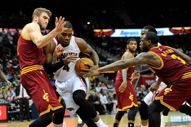 Apr 4, 2014; Atlanta, GA, USA; Atlanta Hawks forward Paul Millsap (4) drives to the basket past Cleveland Cavaliers center Spencer Hawes (32) and guard Dion Waiters (3) during the second half at Philips Arena. The Hawks defeated the Cavaliers 117-98. Mandatory Credit: Dale Zanine-USA TODAY Sports
