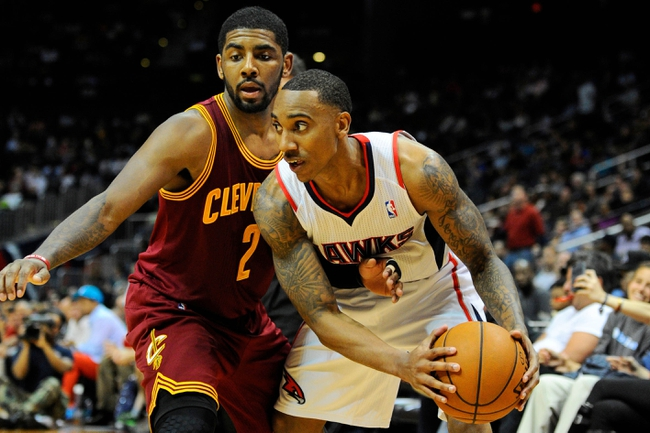 Apr 4, 2014; Atlanta, GA, USA; Atlanta Hawks guard Jeff Teague (0) protects the ball from Cleveland Cavaliers guard Kyrie Irving (2) during the second half at Philips Arena. The Hawks defeated the Cavaliers 117-98. Mandatory Credit: Dale Zanine-USA TODAY Sports
