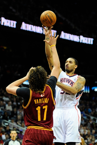 Apr 4, 2014; Atlanta, GA, USA; Atlanta Hawks forward Mike Scott (32) shoots over Cleveland Cavaliers center Anderson Varejao (17) during the second half at Philips Arena. The Hawks defeated the Cavaliers 117-98. Mandatory Credit: Dale Zanine-USA TODAY Sports