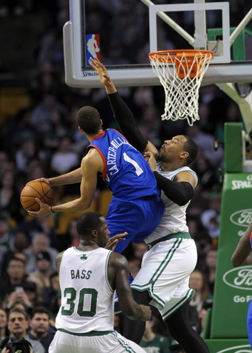 Apr 4, 2014; Boston, MA, USA; Philadelphia 76ers guard Michael Carter-Williams (1) drives to the basket while Boston Celtics center Jared Sullinger (7) defends during the second half at TD Garden. Mandatory Credit: Bob DeChiara-USA TODAY Sports
