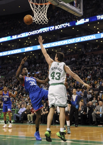 Apr 4, 2014; Boston, MA, USA; Philadelphia 76ers center Henry Sims (35) shoots the ball over Boston Celtics center Kris Humphries (43) during the first half at TD Garden. Mandatory Credit: Bob DeChiara-USA TODAY Sports