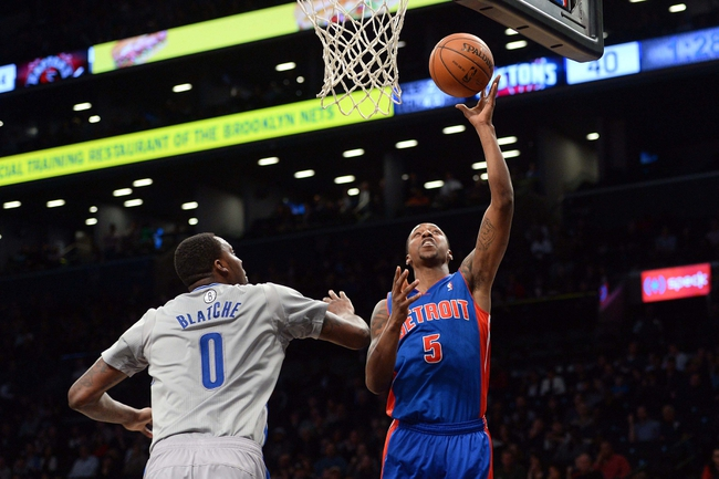 Apr 4, 2014; Brooklyn, NY, USA; Detroit Pistons guard Kentavious Caldwell-Pope (5) shoots over Brooklyn Nets center Andray Blatche (0) during the first half at Barclays Center. The Nets won 116-104. Mandatory Credit: Joe Camporeale-USA TODAY Sports