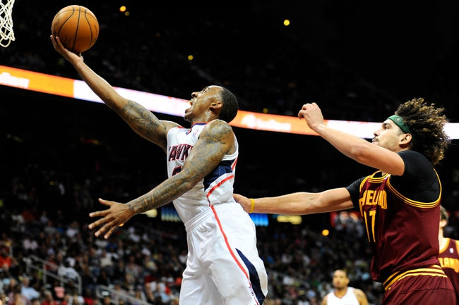 Apr 4, 2014; Atlanta, GA, USA; Atlanta Hawks guard Jeff Teague (0) drives to the basket past Cleveland Cavaliers center Anderson Varejao (17) during the second half at Philips Arena. The Hawks defeated the Cavaliers 117-98. Mandatory Credit: Dale Zanine-USA TODAY Sports