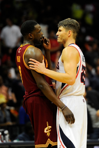 Apr 4, 2014; Atlanta, GA, USA; Cleveland Cavaliers forward Luol Deng (9) and Atlanta Hawks guard Kyle Korver (26) meet after the game at Philips Arena. The Hawks defeated the Cavaliers 117-98. Mandatory Credit: Dale Zanine-USA TODAY Sports