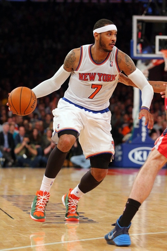 Apr 4, 2014; New York, NY, USA; New York Knicks small forward Carmelo Anthony (7) controls the ball against the Washington Wizards during the fourth quarter of a game at Madison Square Garden. The Wizards defeated the Knicks 90-89. Mandatory Credit: Brad Penner-USA TODAY Sports