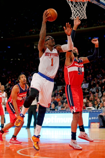 Apr 4, 2014; New York, NY, USA; New York Knicks power forward Amar'e Stoudemire (1) drives on Washington Wizards power forward Drew Gooden (90) during the fourth quarter of a game at Madison Square Garden. The Wizards defeated the Knicks 90-89. Mandatory Credit: Brad Penner-USA TODAY Sports