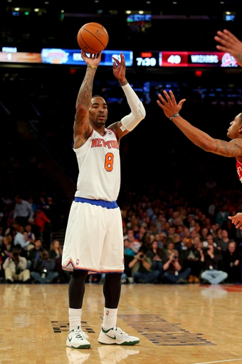 Apr 4, 2014; New York, NY, USA; New York Knicks shooting guard J.R. Smith (8) controls the ball against the Washington Wizards during the third quarter of a game at Madison Square Garden. The Wizards defeated the Knicks 90-89. Mandatory Credit: Brad Penner-USA TODAY Sports