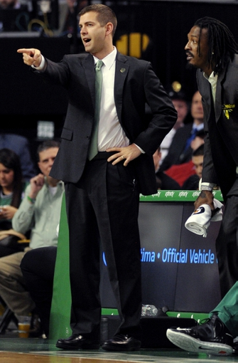 Apr 4, 2014; Boston, MA, USA; Boston Celtics head coach Brad Stevens points to the court during the first half against the Philadelphia 76ers at TD Garden. Mandatory Credit: Bob DeChiara-USA TODAY Sports